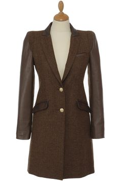 The City Chelsea Coat in Mocha Fitted tweed coat Trimmed with the finest faux snake skin top collar and pockets, accompanied by leather sleeves and back yoke. This coat creates a slimming silhouette and the extended shoulder enhances the small of the waist creating an incredibly flattering image.