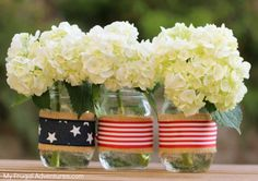 Turn the average mason jar into an adorable patriotic display for this year's Fourth of July with this easy and fun DIY craft. Patriotic Party, Patriotic Crafts, Patriotic Decorations, Patriotic Wreath, Fourth Of July Decor, 4th Of July Party, July 4th, Fun Diy Crafts, July Crafts