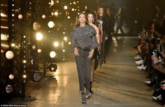 Leading the way: The modelling talent oozed confidence and style as she strode with attitude down the catwalk in a shimmering frilled top and grey trousers adorned with metallic detailing