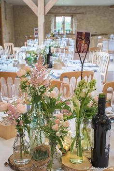 A 'Sweet & Simple' wedding table design using log slices & bottles. Bristol florists, The Wilde Bunch at Kingscote Barn Barn Wedding Flowers, Kingscote Barn, Log Slices, Florists, Simple Weddings, Bristol, Wedding Table, Countryside, Bottles