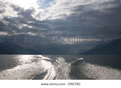 Clouds,wake Of The Boat,lake Como,lecco,italy Stock Photo, Picture And Royalty Free Image. Pic. 66094660