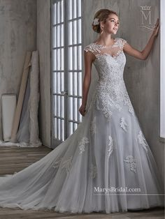 5aa0c759a2 A crystal-beaded belt accents this Marys Bridal 6593 A-line wedding dress