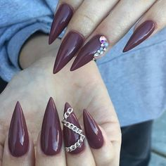 Deep maroon stiletto nails with gold chain features.  by thenailbarsydney http://ift.tt/1NRMbNv