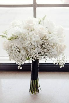 Love this all white bouquet of baby's breath, hydrangea and roses by The Flowerman.