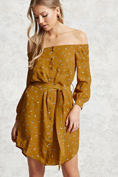 A crinkled woven mini dress featuring an off-the-shoulder neckline, a floral print, snap-button placket, dual chest pockets, a waist sash belt, and long snap-button cuff sleeves.