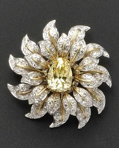 Fancy Vivid Yellow Diamond and Diamond Brooch, centering a pear-shape diamond weighing 3.68 cts., within an 18kt bicolor gold openwork leaf mount set with 176 single-cut diamonds, approx. total wt. 1.00 cts., dia. 1 1/2 in.
