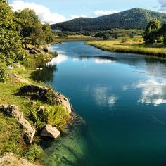 gacka river - beautiful clean river in gacko field (lika)