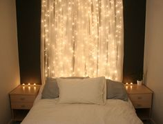 Beautiful Light Curtain! - DIY - Simple sheer curtain + xmas lights hanging behind. This would be great in a kids' room or master bedroom.