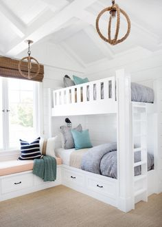 HGTV presents a kids' coastal bedroom that features shiplap walls, built-in bunk beds, nautical light fixtures, and whimsical elements such as a surfboard and lifeguard chair.
