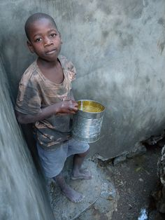 This boy is one of the first to draw water from the new water catchment system in Ennery, #Haiti