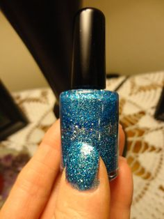OMG...Tealin Blue nail polish is super glittery and sooo sooo pretty. Mixed with light blue, colbalt blue, yellow and silver this color is STUNNING!!. I guess it's a blue teal color but for sure it is amazing!! Paris Sparkles nail polish stands alone. If you want to add a clear top coat for maximum shine, no problem but never necessary. Shown with two coats of polish, no top coat.