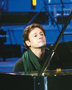 at the piano...