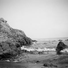 Sun, sand, and the dull hum of waves crashing against the rocks. What else  could you need?  Taken with a Polaroid Land camera and Fuji Pack Film in Malibu, CA.