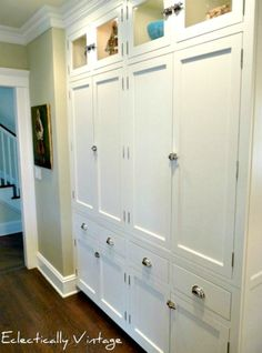 I like these cabinets that go from from to ceiling...want to do something like this around the kitchen Window wall