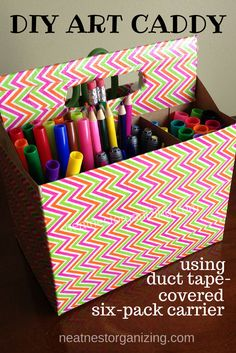 DIY Art Caddy - made from a six-pack carrier and colorful duct tape.  The sections make it easy to keep like-items organized and the handle makes it portable, too.  -Neat Nest Organizing