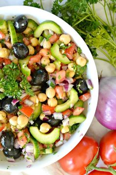Looking for healthy lunch ideas? This Chickpea Cucumber Salad is naturally vegan and gluten-free, and full of healthy vegetables and beans. It's also great as a summer side dish or for bringing to potlucks. #salad #lunch #vegan #glutenfree #healthy #chickpea #cucumber #tomatoes #olives