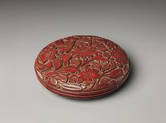 Box with Camellias,Southern Song Dynasty. 13th century  China. Carved red lacquer.