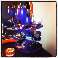 Diy makeup organizer!  Dishes from dollar tree, spray paint, and epoxy.  I put candle sticks to make tiers and added glasses and small dishes from brushes and little things!  So easy!