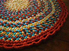 The colors in this hand braided rug just blow me away.