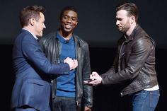 Robert Downey Jr. (Iron Man) and Chris Evans (Captain America) play rock/paper/scissors -- CIVIL WAR! -- onstage at Marvel's big announcement last fall, as Chadwick Boseman (Black Panther) looks on.