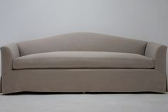 Sunrise Sofa - The Sunset sofa is an iconic piece. Attached back cushion with single seat cushion makes any spot sit-able (or sleep-able). Camelback design resembles a sunrise over flat seas. Make this custom piece even more couture with accent pillows and throws. Customize the arms, skirt or shape to fit your room and style.
