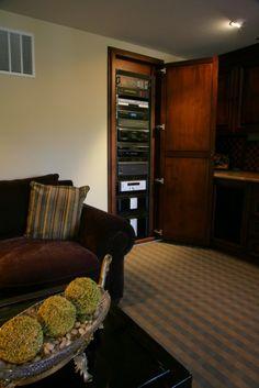 hidden closet for media equipment