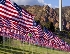 """For the past five years, the Pepperdine University community in Malibu, CA, places nearly 3,000 flags on the front lawn of its main campus. Each flag represents a life   that was lost during the terrorist attacks. Here's a link to a video about the 2011 """"Wave of Flags"""" Memorial: http://vimeo.com/15694393"""
