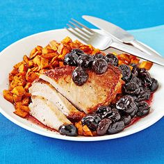 """Pork chops w/cherry chutney and spiced sweet potatoes...yummy! Not an """"every week"""" meal, but tasty and something different! Had to add more salt and some cayenne to the potatoes - otherwise they tasted too much like Thanksgiving yams..."""