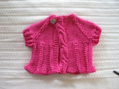 Tiny Cables Baby Sweater by Carmen Oliveras