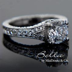 Image from http://www.miadonnadiamondblog.com/wp-content/uploads/2010/11/MiaDonna-Antique-Engagement-Ring-Bella-3.jpg.