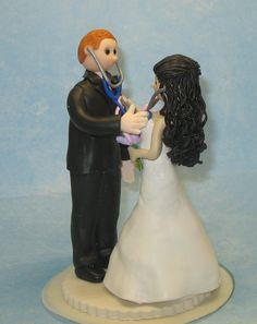Custom Wedding Cake Topper Bride and Groom with stethoscopes by MandMClayCreations on Etsy https://www.etsy.com/listing/195057392/custom-wedding-cake-topper-bride-and