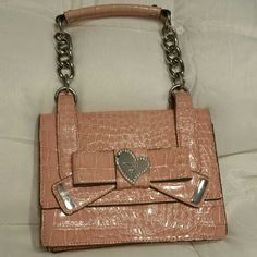 Guess handbag Adorable authentic guess handbag in light pink faux croc with chain handle, silver hardware and logo lining. One rhinestone missing in the heart on front, otherwise no stains and in great condition. Guess Bags Mini Bags