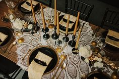 Black Gold Wedding black and gold tablescape - with lace feathers. so pretty perfect for a winter wedding - Gold leaf crown. Chandelier Bougie, Chandeliers, Gold Wedding Decorations, Reception Decorations, Non Floral Centerpieces, Centrepiece Ideas, Centrepieces, Table Centerpieces, Black Tablecloth