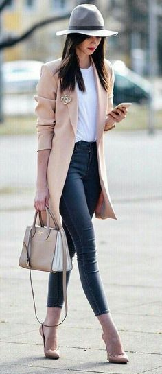 Blush coat over white tee and jeans.