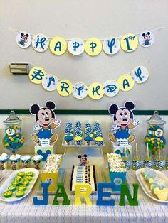 Baby Mickey Mouse birthday party dessert table and banner! See more party planning ideas at CatchMyParty.com!