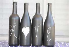 This is cute to and easy to make, you could even do live one one table, love on another and laugh on another.  These are just wine bottles, but you could use any glass bottle