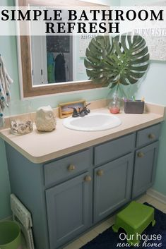Simple bathroom refresh, how to repair a hold in the drywall and refresh a bathroom in just a few steps. This DIY home renovations was done in one afternoon! Making it a low cost, simple and effective way to makeover a bathroom.