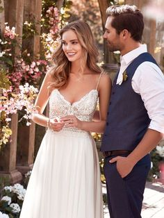 Juniper by Rebecca Ingram This chiffon inspired wedding dress features a sheer bodice accented in beaded lace atop a chiffon skirt. A V-neck, V-back, and beaded spaghetti straps complete this sheath gown.