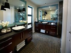 Photos of the master bathroom at HGTV's Green Home 2011 showcase a Zen design aesthetic that continues a theme established in the master bedroom and, along with the creative use of mosaic tile and wood cabinetry, gives the bath a spa-like feel.