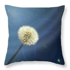 Dandelion Magic throw pillow. flowers, nature. Also available as prints, posters, phone cases, pillows, tote bags, coffee mugs, spiral notebooks, fleece blankets, yoga mats, and on T-shirts.