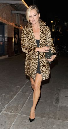 Must have this coat...and the makeup is beyond!