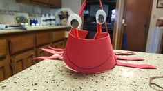 Crab hat made from craft foam. Large Google eyes, pipe cleaners and elastic string.