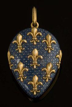 A nineteenth-century yellow-metal and blue-enamel pear-shaped locket, the enamel front applied with fleur-de-lys motifs, a symbol of France. (Reeman Dansie)
