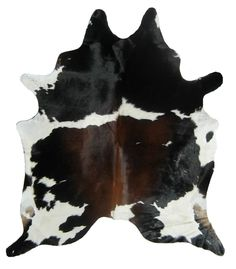 Enamored with the idea of these cowhide rugs. Have seen them -- and loved them -- in zebra, but they're a little obvious. Still, not sure about bringing home a big hunk of skin and hair and putting my bare feet on it. Huh.