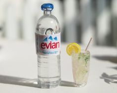 1/12 scale Dollhouse Miniature Evian Drinks Set. $8.80, via Etsy.
