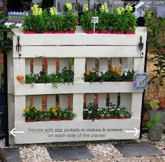 Pallet Planter for the garden..check out the cute little hooks made from garden tools..