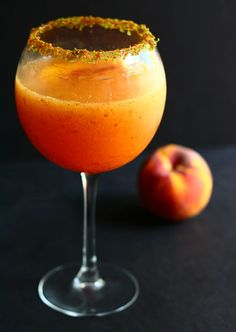 Peach-a-ritas: 4 oz. tequila, 2 oz. triple sec, 1.5 oz. freshly squeezed lime juice, 2 tsp Grand Marnier (optional, but delicious) 1/2 peach,1 cup ice, Garnish glass with lime zest and coconut sugar or lime zest and sea salt