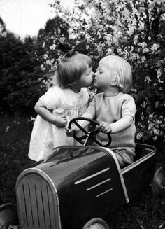 Pedal car romance.  See, even to this day, girls are attracted to muscle cars.