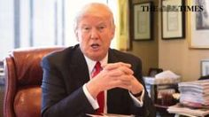 Photo showing Mr Trump behind his desk during his interview with The Times.