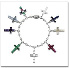 """Wallis Simpson (Duchess of Windsor)'s Cartier cross charm bracelet. A gift from King Edward VIII, who abdicated the throne to marry her. Composed of various jewels, with each cross a symbol of an event in their lives and inscribed with messages such as """"God Save the King for Wallis"""" and """"The King's Cross God Bless WE [Wallis & Edward]."""""""